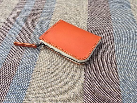 quality design d10ca f6b14 クレーブスオレンジのヌメ革のL字財布